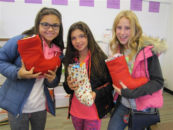 Glen Crest students pack hundreds of stockings to send to soldiers during holidays