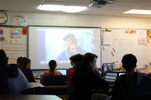 Students talk with Canadian teacher